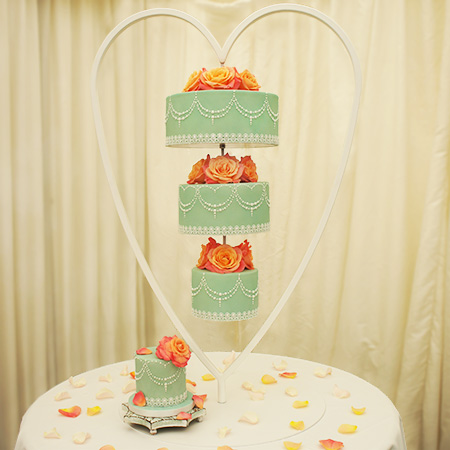 Chandelier hanging wedding cake airbrushed sage with fresh miss piggy roses royal and icing piped detail chandelier upside down wedding cake mozeypictures Image collections