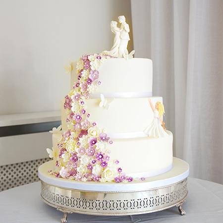 Cascading Purple Flowers And Little Girl Wedding Cake